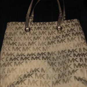 Golden Michael Kors purse